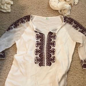 white and maroon top